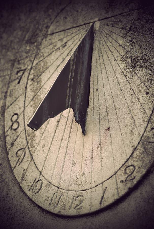 Sundial. Close up of ancient sundial on rock stock photos
