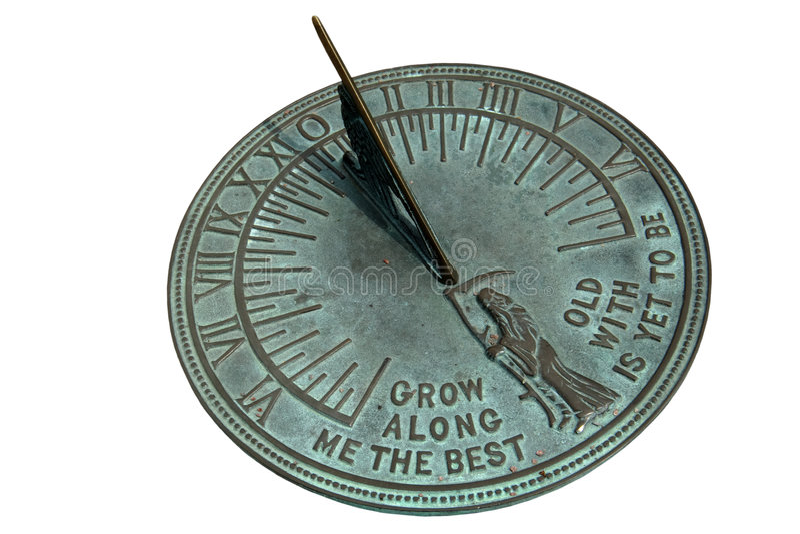 Sundial. Brass sundial isolated on white stock image