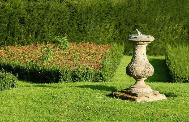 Sundial. Masonry sundial in a summer garden stock image