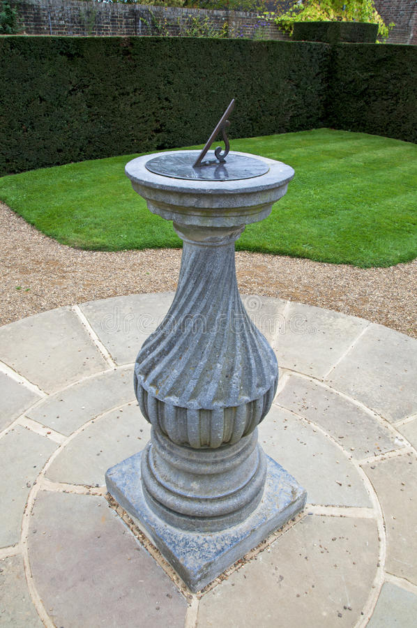 Download Sundial in a formal garden stock image. Image of chronometer - 21484691