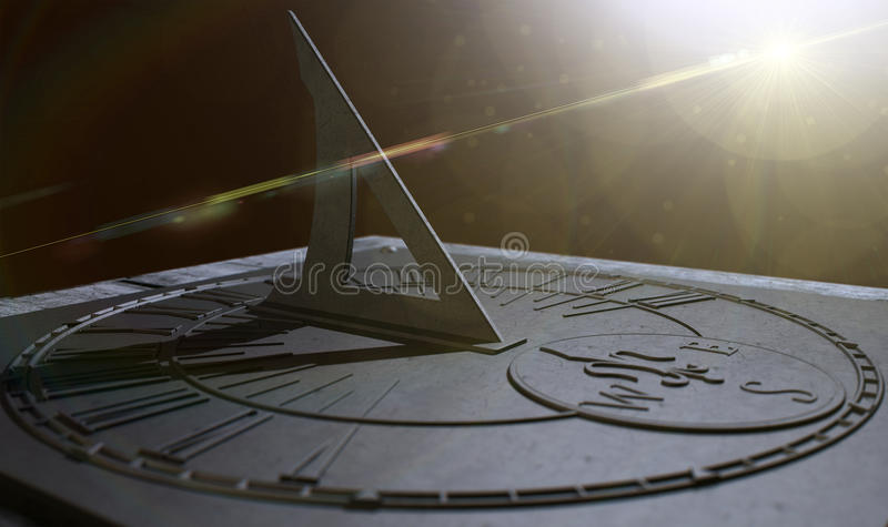 Sundial Lost In Time. An extreme closeup of a section of an old vintage sundial clock made of scratched metal with roman numerals on a dark background royalty free stock images