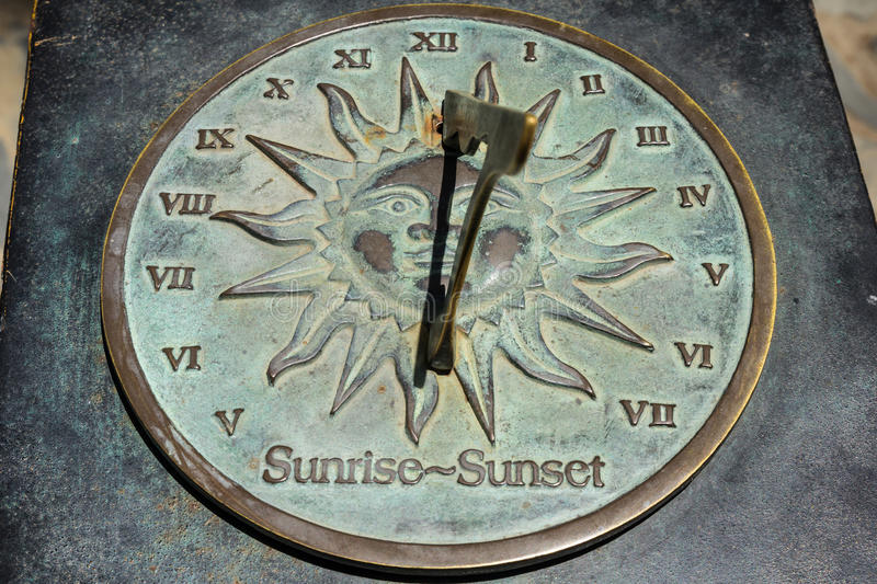 Sundial. Old sun clock dial - Vintage sundial with shadow stock photo