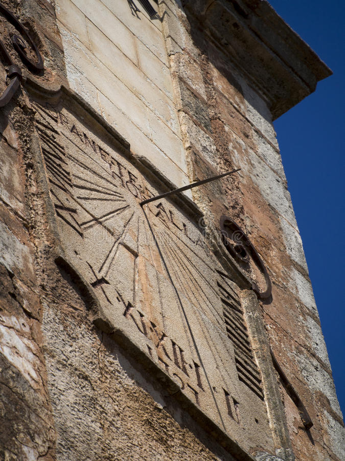 Sundial in Roussillon, France. Roussillon is a commune in the Vaucluse department in the Provence-Alpes-Côte d'Azur region in southeastern France. It is noted stock photos