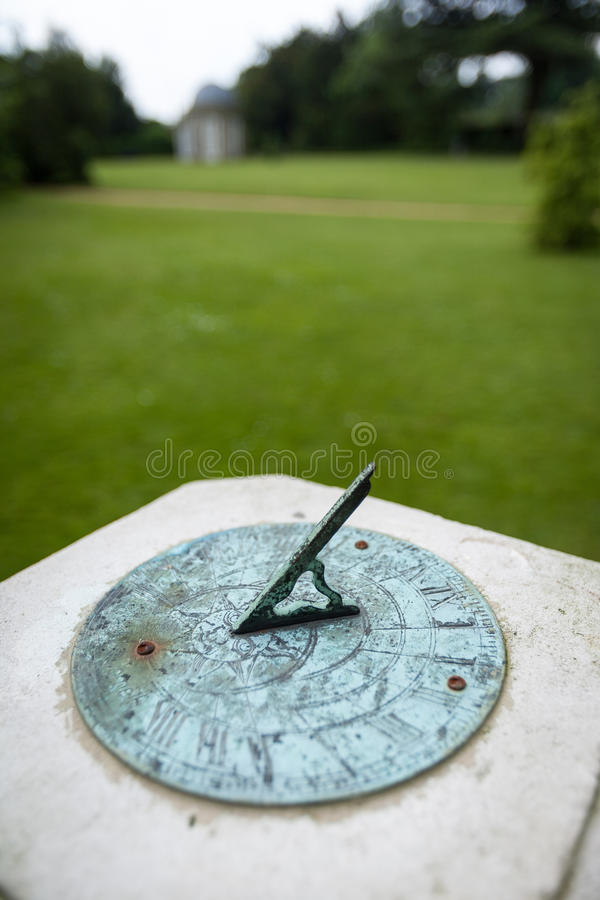 Sundial. Shallow focus on a sundial in an English parkland setting royalty free stock photo