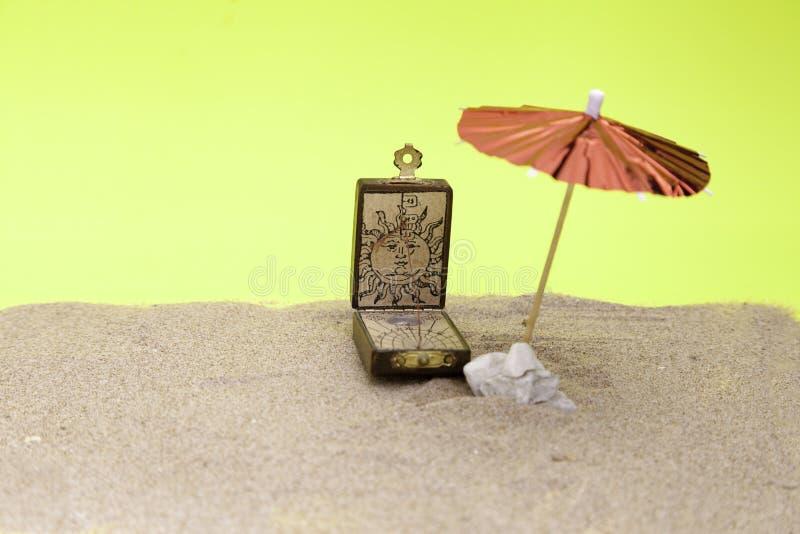 Sundial and umbrella beach royalty free stock image