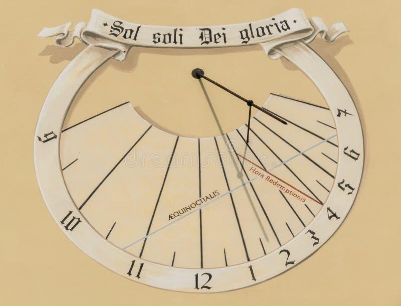 Sundial. On the wall of a church tower. Torbole, Trentino, Italy royalty free stock photos
