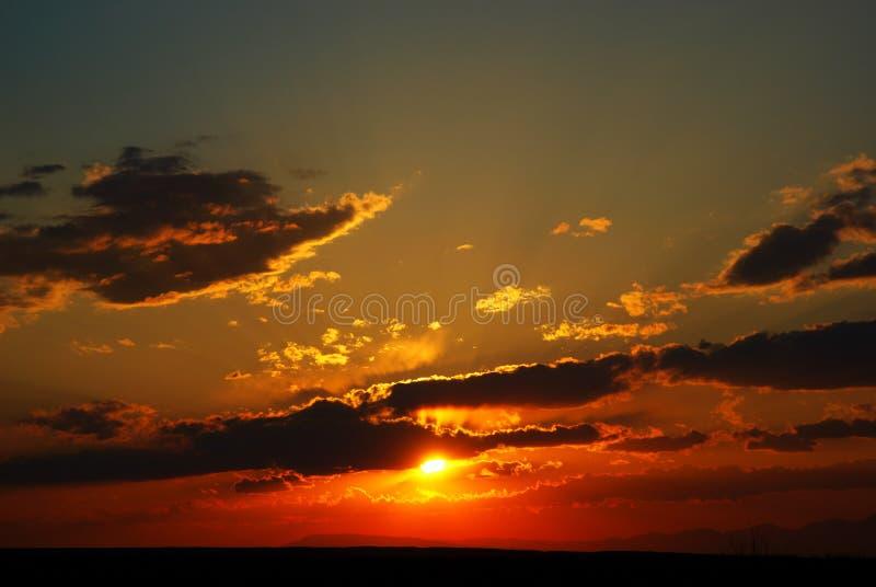 Sundown in clouds stock photo