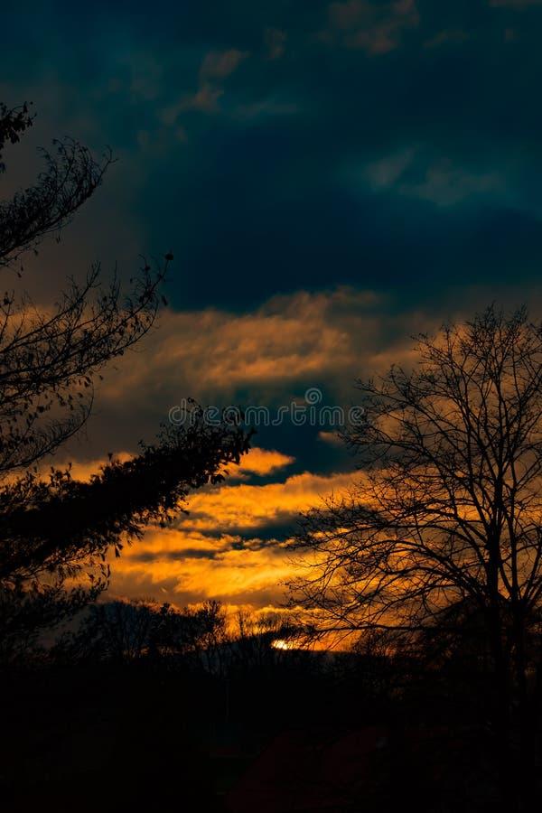 Sundown with a dark blue clouds. royalty free stock photos