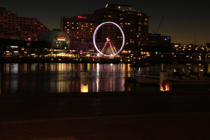 Sundown happy time at Darling Harbour at Night. Darling Harbour is a harbour adjacent to the city centre of Sydney, New South Wales, Australia. It is also a royalty free stock image
