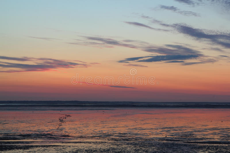 Sundown over mudflat. Sun going down over mudflat at the german north sea coast stock image