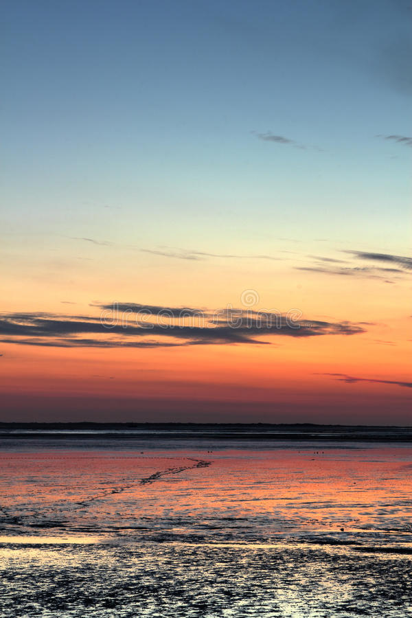 Sundown over mudflat. Sun going down over mudflat at the german north sea coast stock photos