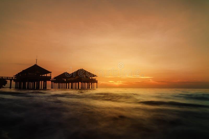 Sundown at Singaraja. Bungalow on the water during sundown at Singaraja, Northern Bali stock images