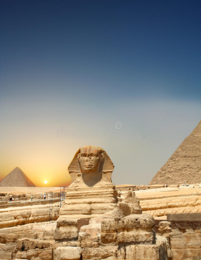 Sundown Sphinx. Great sphinx in front of pyramid, Giza, Cairo, Egypt royalty free stock photography