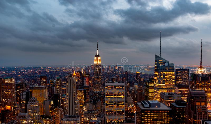 Sundown from the top of the rock - Empire State Building lit in the centre of the frame - in colour stock image