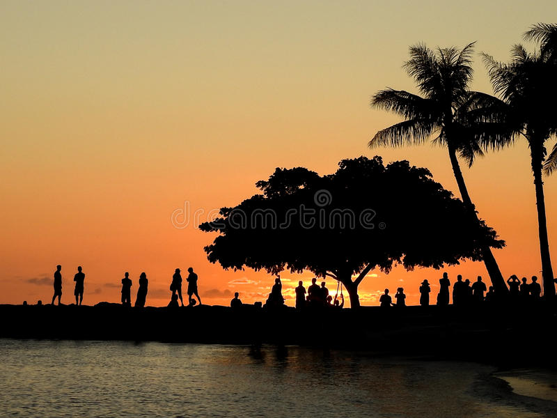 Sundown in Waikiki. An appreciative silhouetted crowd gathers to share the end of another day in Waikiki royalty free stock photos