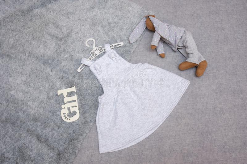Sundress for a girl of gray color from cotton fabric stock photo