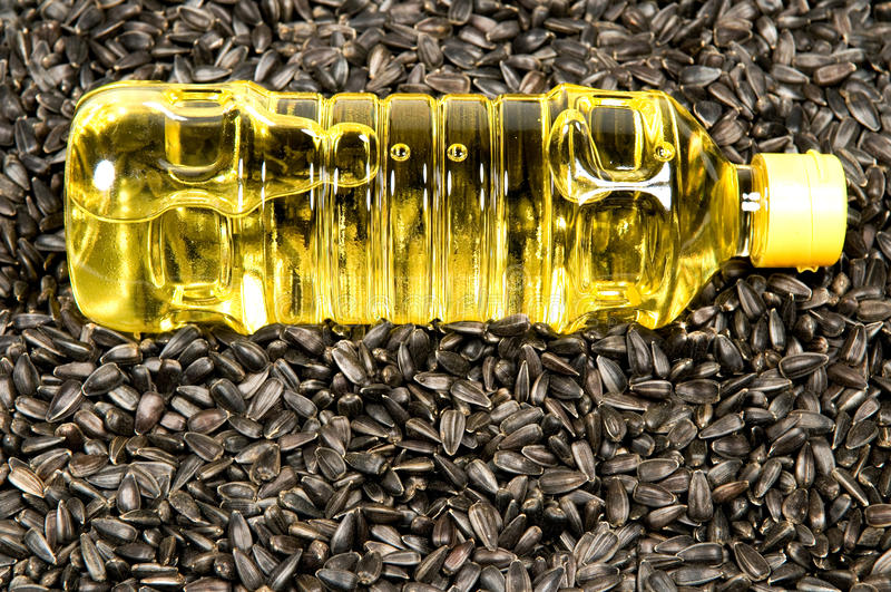 Download Sunflower-seed oil. stock photo. Image of plastic, sunflower - 13057680