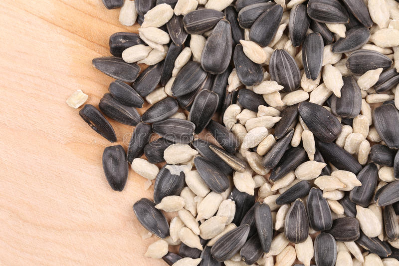 Download Sunflower Seeds Black And White On Wooden Board Stock Photo - Image: 38773914