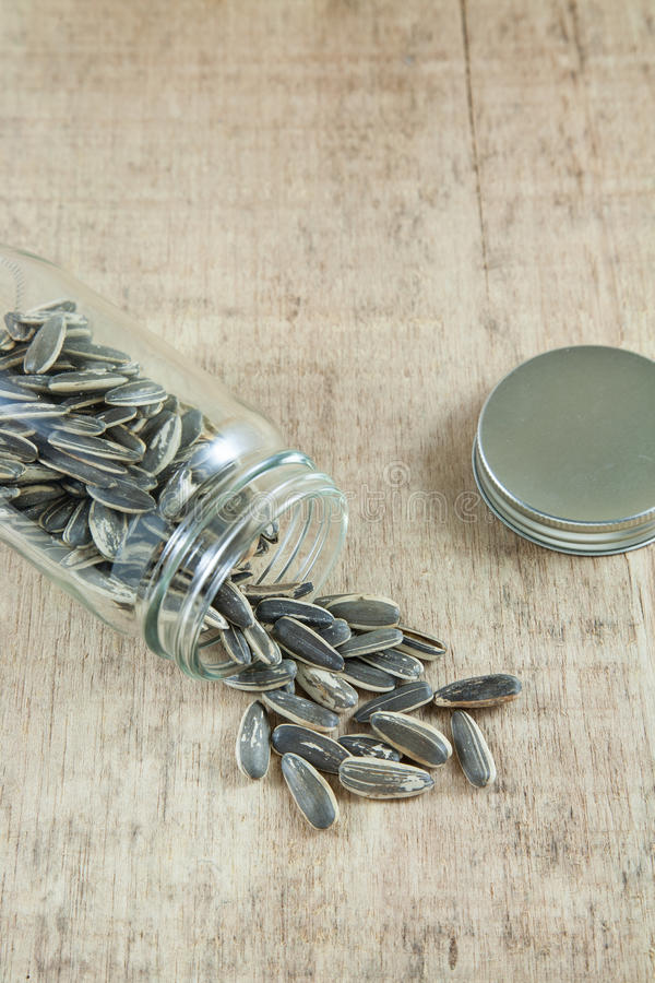 Sunflower seeds and bottle. royalty free stock photography