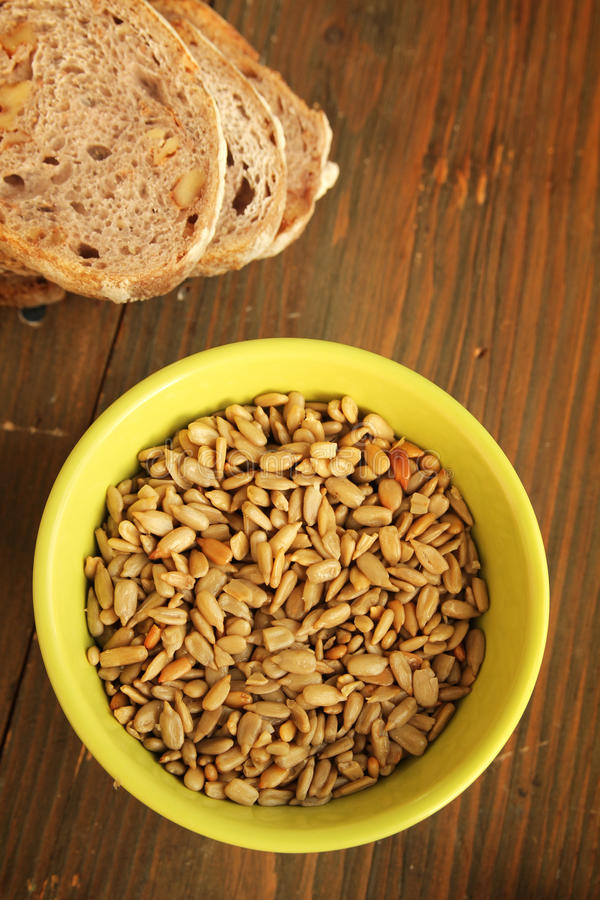 Download Sunflower seeds and bread stock photo. Image of isolated - 27879500