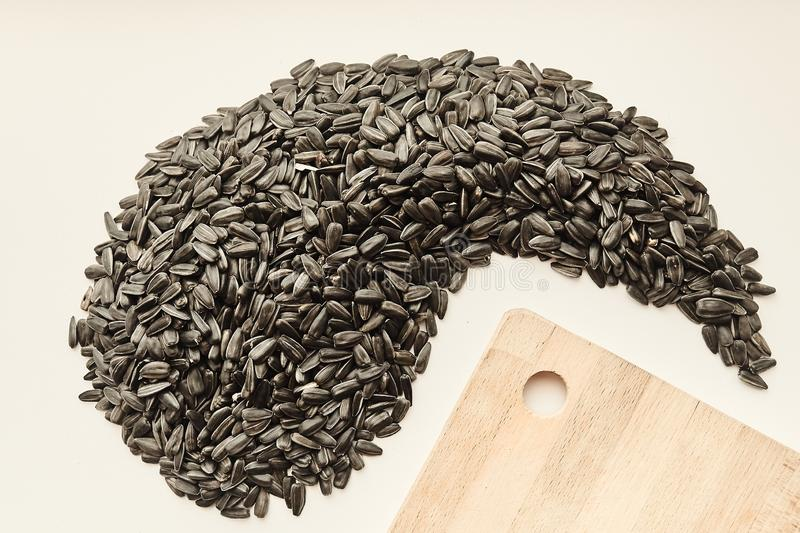 Sunflower seeds on a white background, creative. stock photo