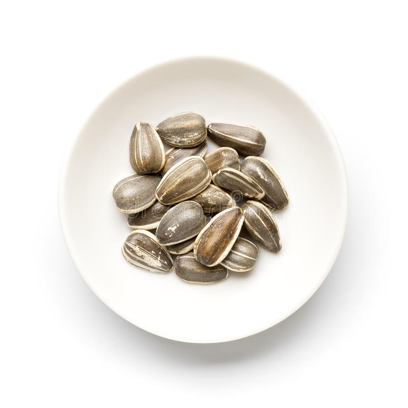 Sunflower seeds. On a white plate stock photography