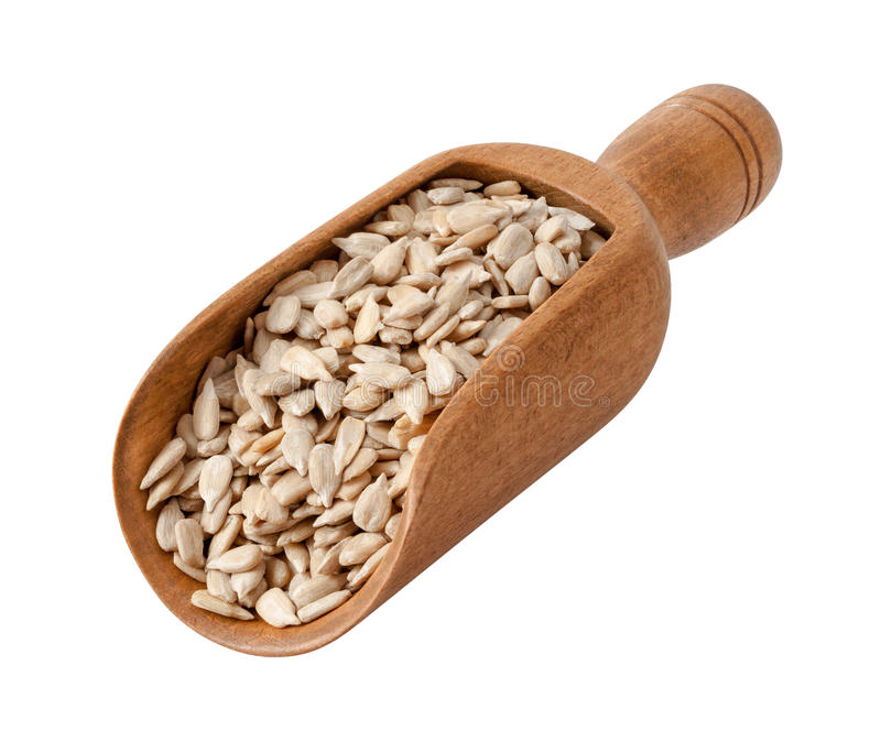 Sunflower Seeds in a Wooden Scoop royalty free stock photos