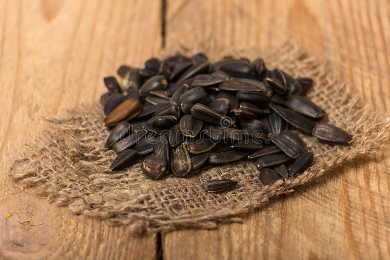 Sunflower seeds. On a wooden table stock images