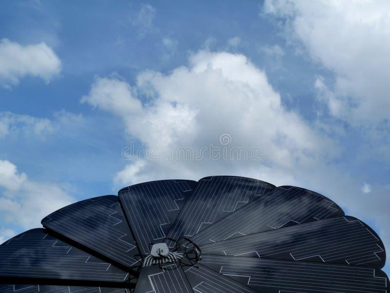 Sunflower shaped solar panel detail under blue sky stock photos