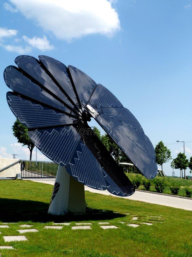 Sunflower shaped solar panel detail under blue sky stock image