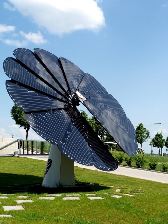 Sunflower shaped solar panel under blue sky royalty free stock photos