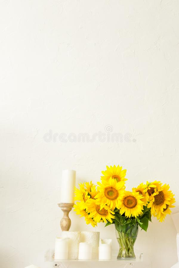 Sunflower on the table in a vase in the interior of a bright room. Sunflower flowers on the table in a vase in the interior of a bright room stock images
