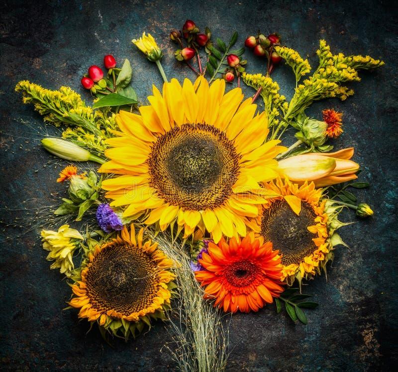 Sunflowers bunch on dark vintage background, top view stock photos
