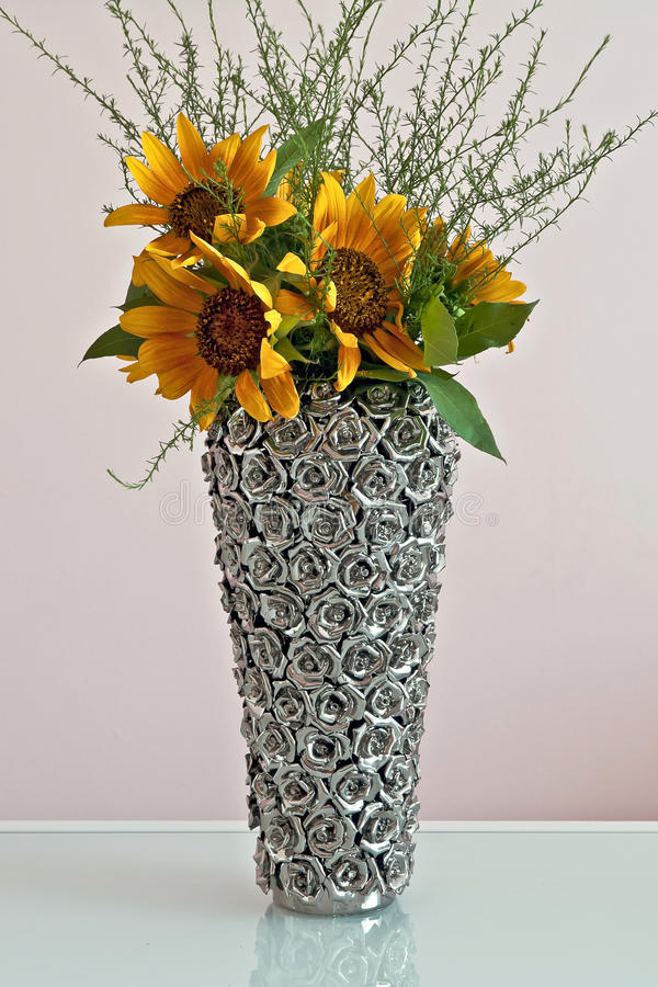Sunflowers in decorative vase stock images