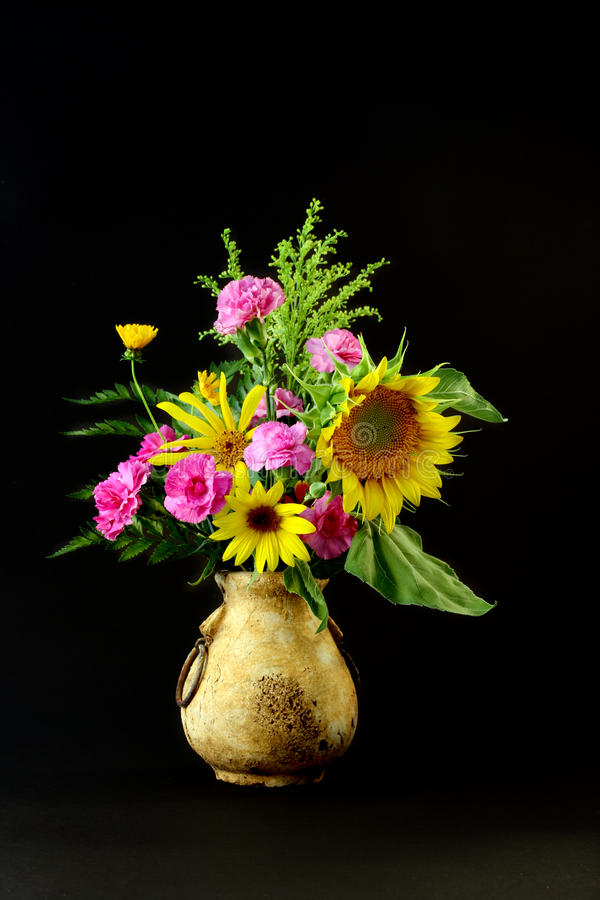 Sunflowers in Old Vase stock image