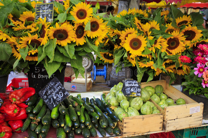 Sunflowers and vegetables for sale at a market in Provence royalty free stock images