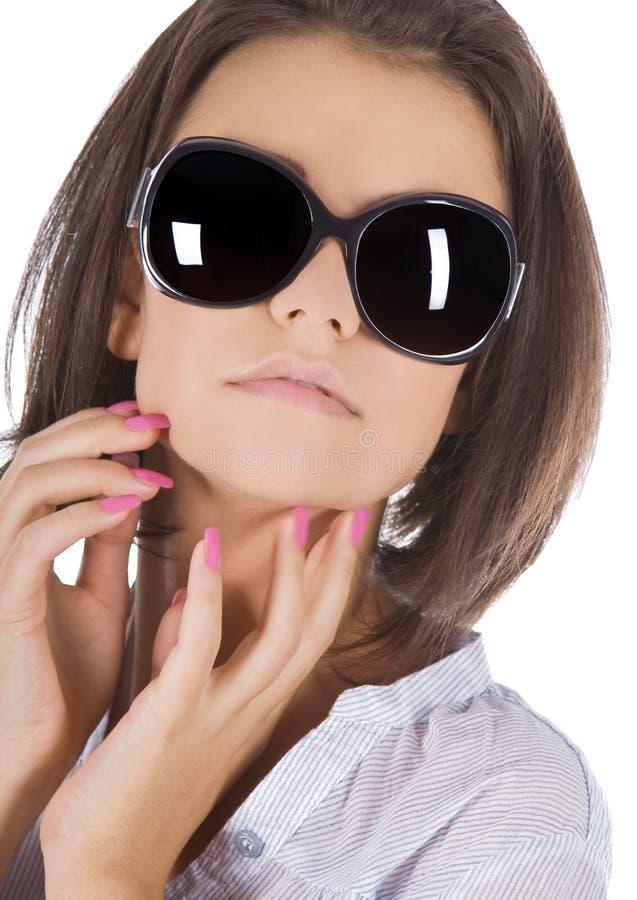 Sunglas desgastando da mulher 'sexy', nova, bonita imagem de stock