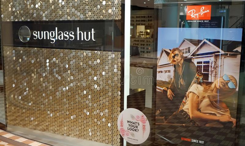 Sunglass Hut retail store exterior with huge Ray-Ban advertisement poster on display. royalty free stock photography