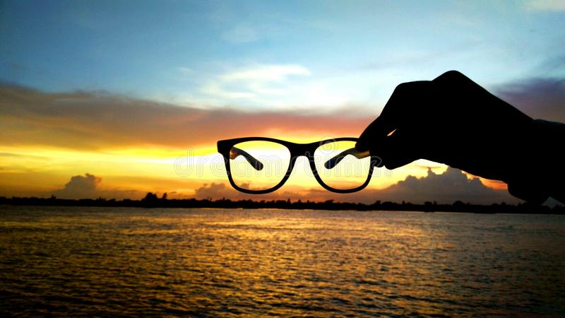 Sunglass sunset stock photography