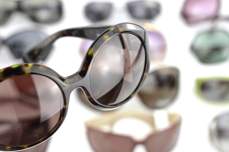 Sunglasses. A pair of sunglasses with glasses background royalty free stock photography