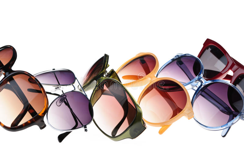 Sunglasses. Different styles of tinted sunglasses on white background royalty free stock photography