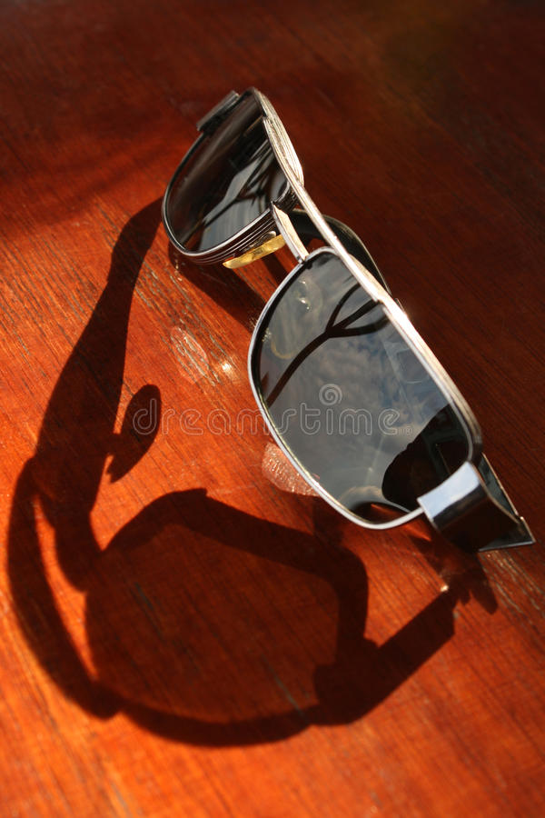 Sunglasses. In sunlight showing protective shadow stock image