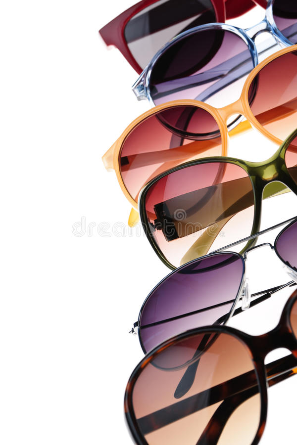 Sunglasses. Different styles of tinted sunglasses on white background stock photography