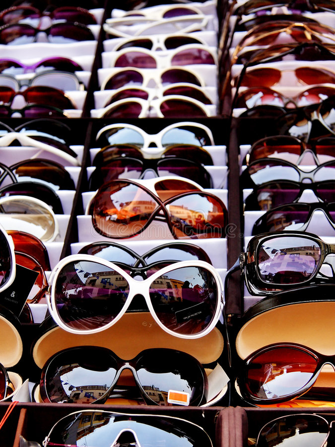 Sunglasses. For sale at retail market royalty free stock photo