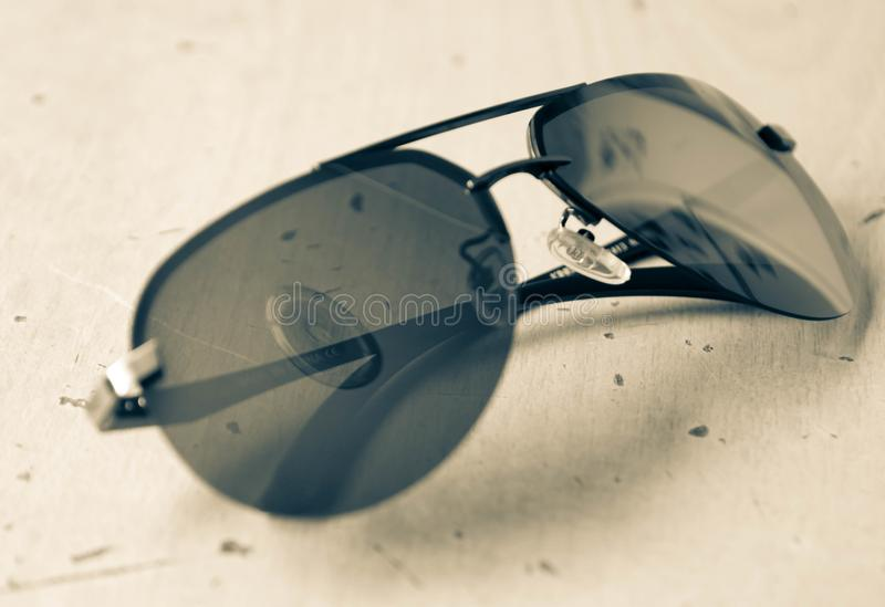 Sunglasses aviators in black and white style subject photography.  royalty free stock images