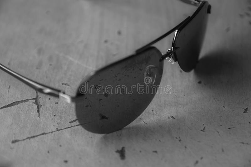 Sunglasses aviators in black and white style subject photography.  royalty free stock photos