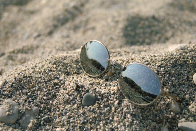 Sunglasses on beach stock photo