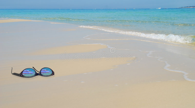 Sunglasses on Beach royalty free stock images