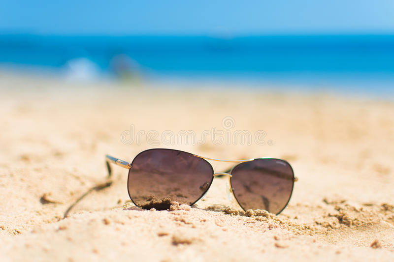 Sunglasses On The Beach Sand And Sea Background Stock ...