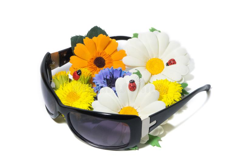 Sunglasses and a bouquet of summer flowers stock photo